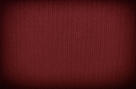 Burgundy red paper textured background with vignette photo