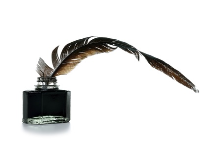 inkwell: Feather and ink bottle on white background Stock Photo