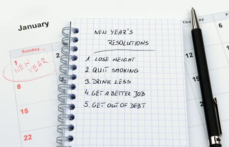 New Year's resolutions listed in circle notepad Stock Photo - 16006706