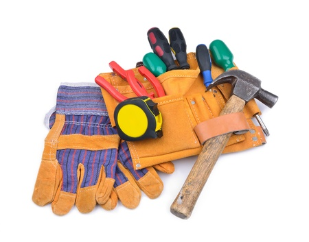 Tool belt and protective gloves on white background Stock Photo