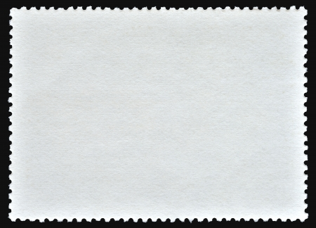 Blank poststamp on black background photo