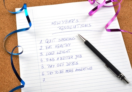 New Years resolutions listed and ribbons Stock Photo