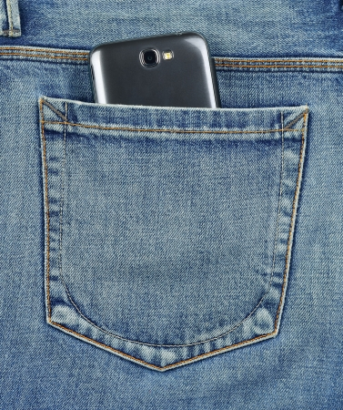 Back pocket of jeans with cell phone, mobile photo