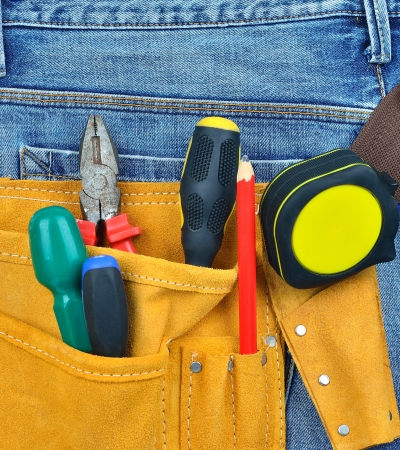 carpentery: Toll belt with tools on back of jeans Stock Photo