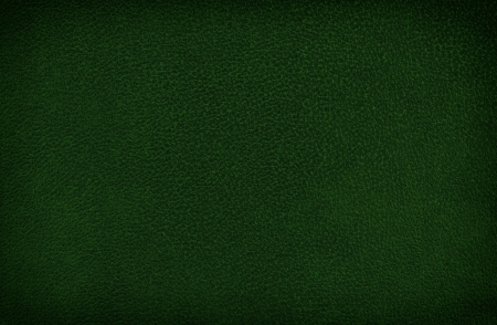 oldened: Closeup detail of olive oldened leather texture background. Stock Photo