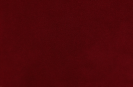Closeup detail of red maroon leather texture background. Stock Photo