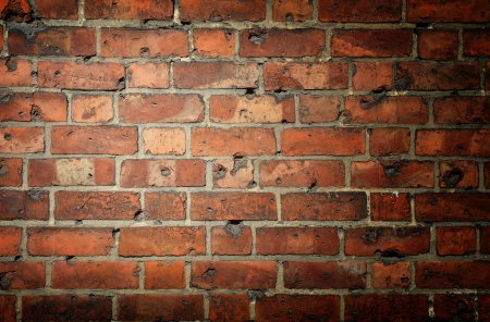old brick wall: Background with brick wall and vignette and a clear field for the text
