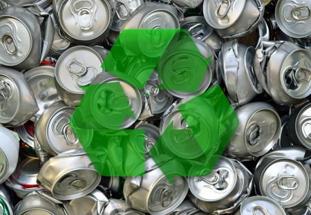 crushed aluminum cans: Crashed beer cans and recycling sign. Waste recycling. Stock Photo