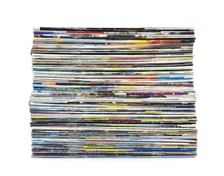 periodical: Stack of colorful magazines on white background Stock Photo