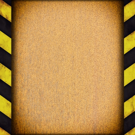 Background with warning stripes and metal rusty plate photo