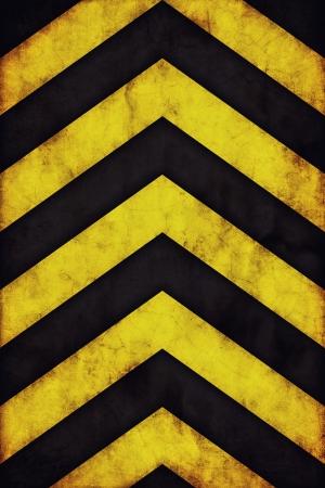 Yellow and black grunge warning stripes background photo