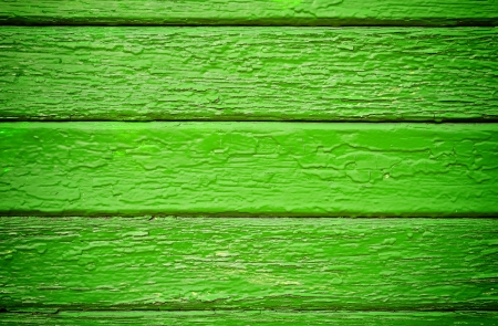 pealing: Old painted green wooden wall