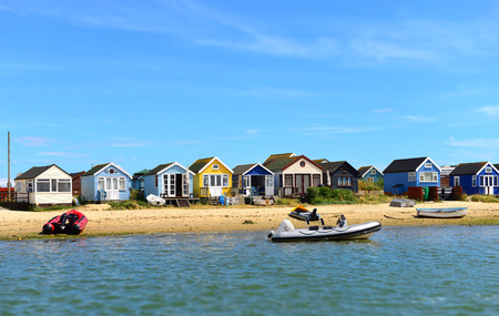 Colored houses on the beach and pontoon  photo