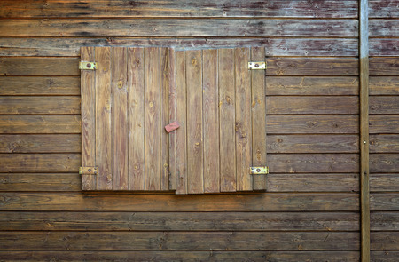 Old wooden shutters with metal hinges photo