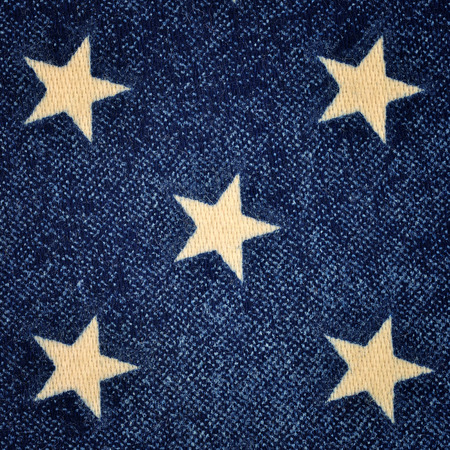 Background made of blue fabric with white stars photo