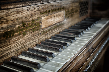 restoration: Closeup of antique piano keys and wood grain