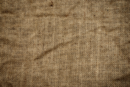 full of holes: Creased, dirty and full of holes burlap background