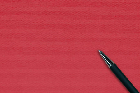 ball pen: Red papper background with black ball pen and text space