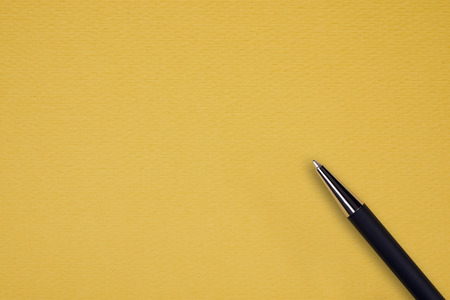 ball pen: Yellow papper background with black ball pen and text space Stock Photo