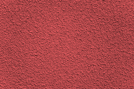 plaster wall: Background made of red textured rugged plaster wall