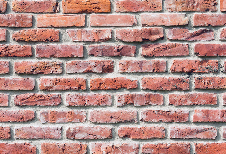 Grunge background made of red bricks