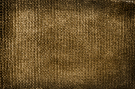 Old, dirty and scratched brown cotton background