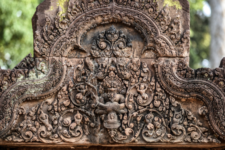 sanskrit: Sculptures on Banteay Srei temple, Angor Wat Cambodia. Stock Photo