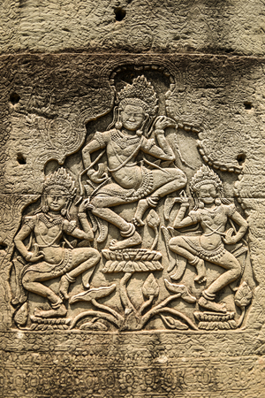 sanskrit: Sculptures of apsara dancers on temple, Angkor Wat Cambodia.