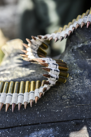 Bullets in ammunition belts outdoor for machine gun.