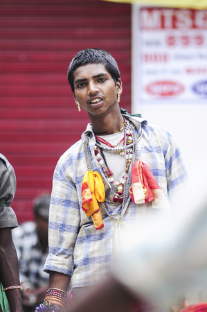 Udaipur, India, september 14, 2010:  A portrait of young boy singing with his group on the street in India. Editorial