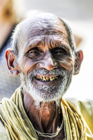 Khajuraho, India, september 17, 2010: Old indian man face smiling and looking on a photographer. Editorial