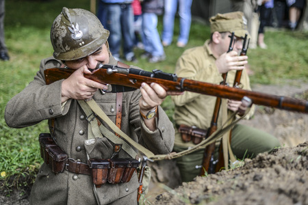 maschine: Szczecin, Poland, march 4, 2012: Historical reconstruction of battle during World War second in Poland, Polish soldier with gun maschine. Editorial