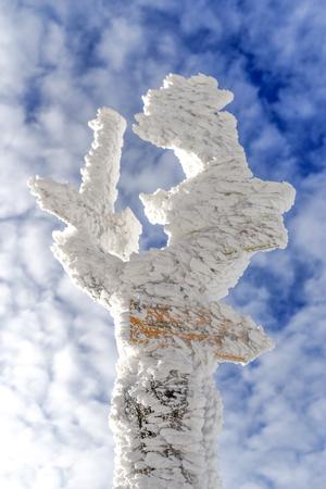 Frozen road trail sign in winter time, Karkonosze mountains.
