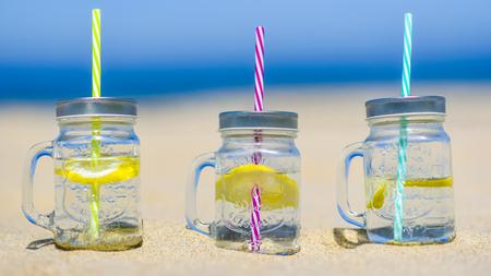 passion fruit flower: Lukecin, Poland, June 15, 2017: Cold drinks in jar on the beach.