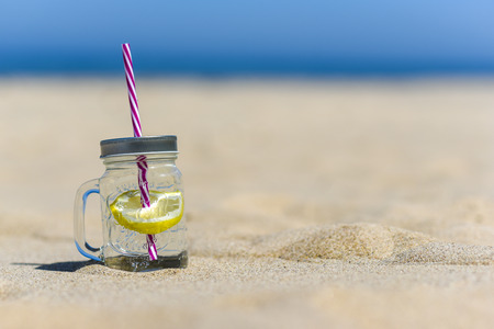 passion fruit flower: Lukecin, Poland, June 15, 2017: Cold drink in jar on the beach with copy space.