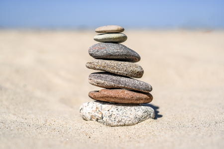 A mound of stones on the beach on a sunny day in summer Stock Photo