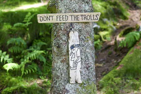 The plate: Dont feed the trolls in forest in Norway. Stock Photo