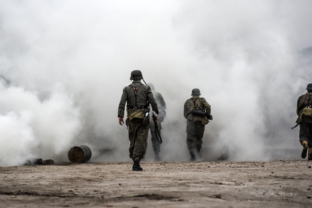 Gryfino, Poland, 23 september 2017: Historical reconstruction of the battle at Arnhem, German soldiers in a cloud of smoke.