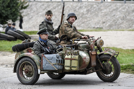 Gryfino, Poland, 23 september 2017: Historical reconstruction of the battle at Arnhem, German soldiers riding on a motorcycle.
