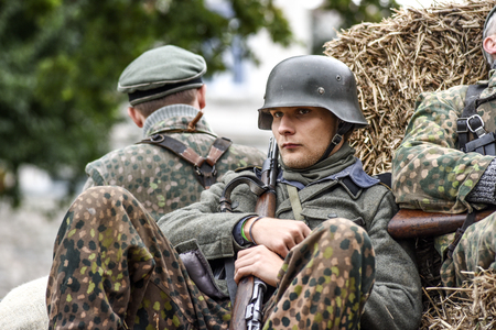 Gryfino, Poland, 23 september 2017: Historic reconstruction of the battle at Arnhem, a soldiers resting in a haystack
