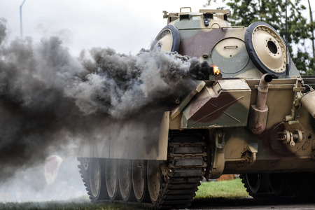 Gryfino, Poland, 23 september 2017: Historical reconstruction of the battle at Arnhem, German tank in the cloud of pride after the explosion.