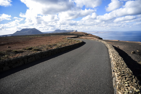 Asphalt road among on the Lanzarote Canary Islands Stock Photo