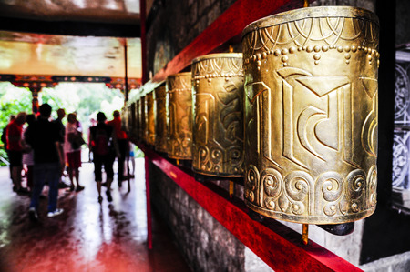 Tibetan prayer wheels in monastery in India. Stok Fotoğraf