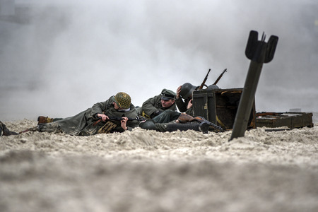 Poland, Kolobrzeg, 17 march 2019: Soldiers fighting on the beach during the reconstruction of the historical battle with WWII