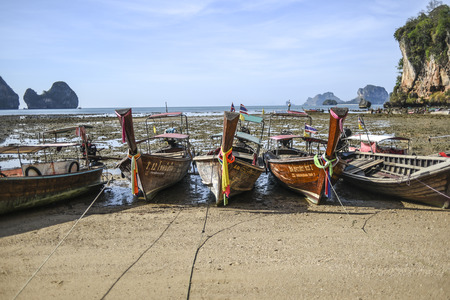 Krabi, Thailand, 13 march 2016: Boats on the beach during low tide in Thailand on the Krabi peninsula.