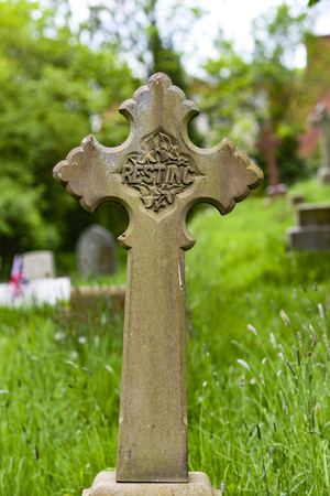 An old cross at a cemetery in England. Banco de Imagens