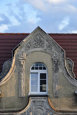 Bas-reliefs on the facade of the tenement house, faces of old people. Фото со стока