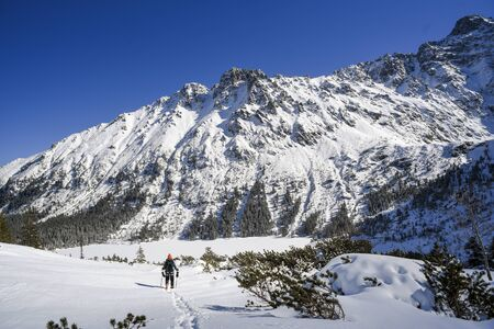 Climber on the winter mountain landscape in the Polish and Slovak Tatra mountains.