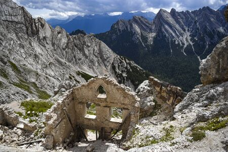 Old, abandoned ruins of Italian fortifications from the Second World War in the Italian Dolomites. Фото со стока