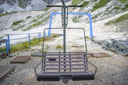 A deserted and unused chairlift in the Italian Dolomites. Фото со стока